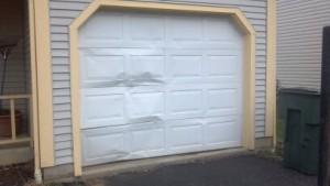 Dented Garage Door_Firstudt.com